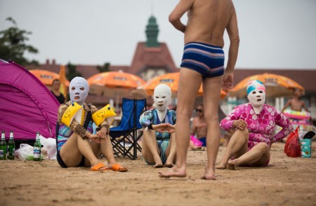 Sunbathers in masks