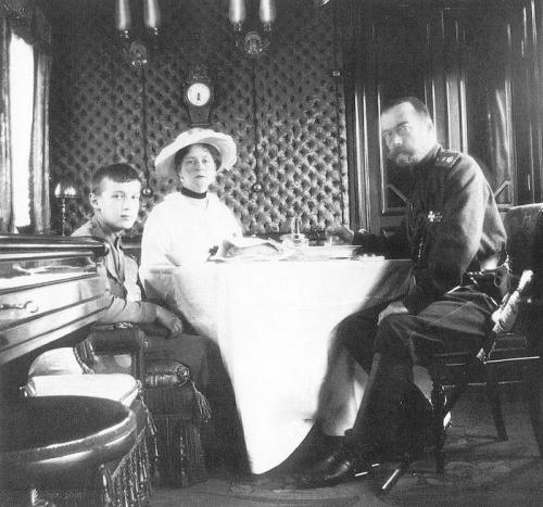 Emperor Nicholas II, Empress Alexandra Feodorovna and the Tsesarevich.  Saloon car of Imperial train. Apprx. 1903.