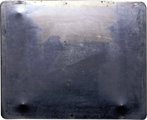 First known photograph by Nicéphore Niépce, 1827. (Heliography. 8 hour exposure. WIndow at Le Gras).