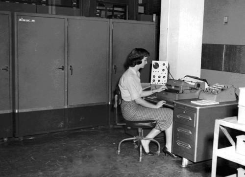 ALWAC III, 1959. Irma Lewis,  NWRC programmer at console.